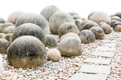 Stone sphere in garden with footpath Royalty Free Stock Photo