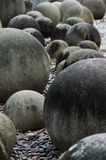 Stone spheres in Thailand stone garden,. National park and zoo.Summr cloudy day stock photography