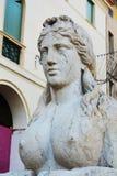 Stone sphinx and neoclassic architecture, detail, in Conegliano Veneto, Treviso, Italy. Sphinx statue, neoclassic architecture, detail and close up, and the Stock Image