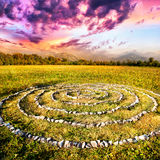 Stone spiral. On the field at mountain and purple sky background in Kazakhstan, central Asia Royalty Free Stock Photography