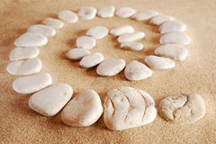 Stone spiral. Spiral from sea stones on sand at the sea Royalty Free Stock Photos
