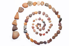 Stone Spiral. Made from the pebbles isolated on the white Stock Image
