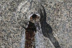 Stone spout of fountain Stock Photos
