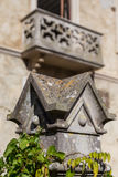 Stone square decoration on pillar of fence Royalty Free Stock Photography