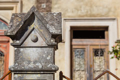 Stone square decoration on pillar of fence Royalty Free Stock Images