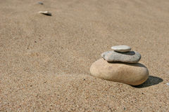 Stone stack. On the sand Stock Image