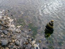 Rocky morning shoreline and stone stack Stock Photo