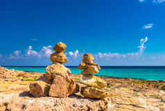 Stone stack balance on the beach. Two stone stacks on the beach, harmony balance concept background Royalty Free Stock Photography