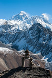 Stone stack, with Mt. Everest in background, Gokyo Ri, Nepal. Stone stack, with western side view of Mt. Everest in background, Gokyo Ri, Nepal Stock Photos