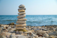 Stone stack on a pebble beach Stock Image