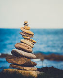 Stone stack. Stack of stones balancd precariously besides the sea Royalty Free Stock Photos