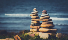 Stone stacks. Stacks of balanced stones on the seashore in Northumberland Royalty Free Stock Photography