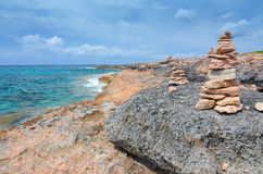 Stone stacks on Majorca sea coast Stock Photo