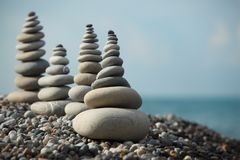Stone stacks on pebble beach Stock Images