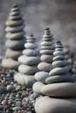 Stone stacks on pebble beach Royalty Free Stock Photo