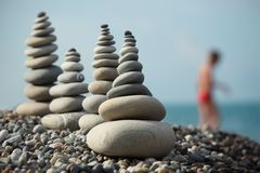 Stone stacks on pebble beach Royalty Free Stock Image