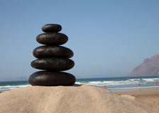 Stone stacks with sea waves Stock Photography
