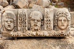 Stone stage masks at Myra Turkey royalty free stock image