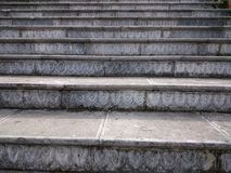 Stone stair with carved grey steps. Ascending steps outdoors in Royalty Free Stock Image