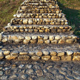 Stone stair. Old stone stairs on the slope grass field Stock Photo