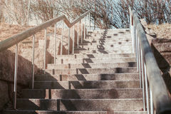 Stone stair with railing in the sun. Stock Image