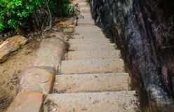 Stone stair steps walking the trail, Smugglers Track with the natural black stone wall at Barrenjoey Lighthouse Walk. stock image
