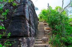 Stone stair steps walking the trail, Smugglers Track with the natural black stone wall at Barrenjoey Lighthouse Walk. stock images