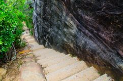 Stone stair steps walking the trail, Smugglers Track with the natural black stone wall at Barrenjoey Lighthouse Walk. royalty free stock image
