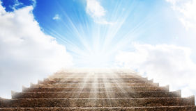 A stone stair in the way up to blue sky, there is a strong light in the end of the way. A stone stair in the way up to blue sky Royalty Free Stock Photo
