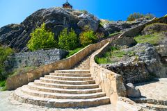 Stone staircase against the blue sky. Among the rocks Royalty Free Stock Image