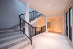 Stone staircase with black iron handrails Stock Image