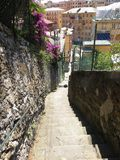 Stone staircase in an Italian village next to Genoa. A stone staircase surrounded by walls in an Italian town on the Mediterranean Sea near Genoa Stock Images