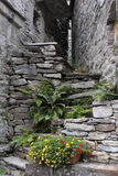 Stone staircase leading to a narrow lane Royalty Free Stock Photo