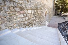 Stone staircase medieval fortress. Stone staircase and medieval building brick old Stock Photos