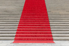 Stone staircase with red carpet Royalty Free Stock Photography