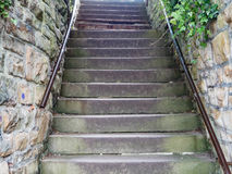 Stone Staircase With Rusty Handrails. At A Sandstone Wall Stock Photos