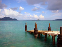 Stone staircase into the sea. Fantastic view on sea and little staircase for fishing and boats in Phuket, Thailand royalty free stock photography