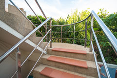 Stone staircase with stainless steel handrails Stock Photo