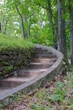 Stone Staircase. Stone steps curve up the side of a hill Royalty Free Stock Photo