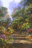 Stone staircase in wood with colorful flowers Stock Image