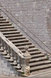 Stone stairs along the wall Stock Photos