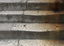 Stone stairs. Detail of stone stairs colored with corroded scraps royalty free stock image