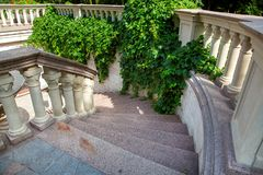 Stone stairs with marble steps go down.