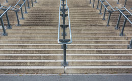 Stone stairs with metal handrails from below. Stone stairs with metal handrails as seen from below stock photography