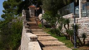 Stone stairs in Montenegro, in Park Milocer, Sveti Stefan. stock footage