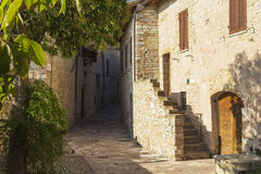 Stone stairs and narrow street in a town from Tuscany Royalty Free Stock Photo