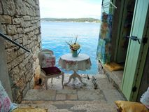STONE STAIRS, PILLOWS AND WHITE CHAIR, ROVINJ, CROATIA Stock Photo
