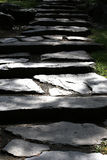 Stone stairs in the shadow. Roughly hewn stones, reflections of the sun Stock Photos