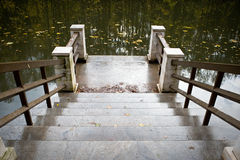 Stone stairs to the lake Royalty Free Stock Photo