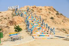 Stone stairs to welcoming sign of Matmata. Tunisia, Africa royalty free stock photography